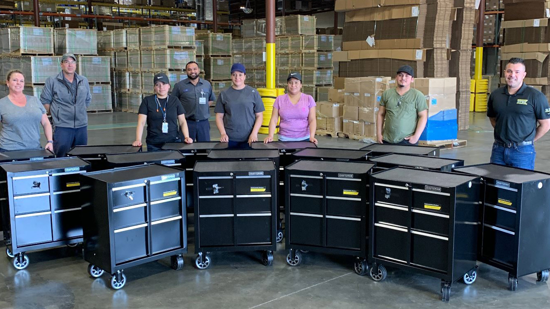 Employees are Stanley Black & Decker gather around for to donate the rolling cabinets to the Western Missouri Medical Center.