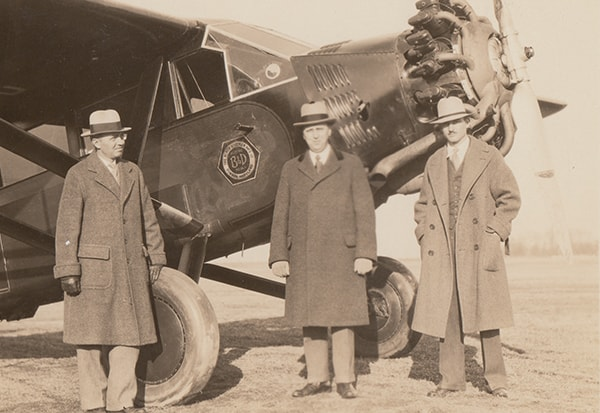 Alonzo G. Decker, Sr., S. Duncan Black, and pilot Bill Snowden