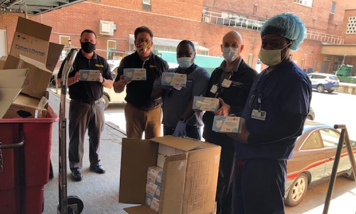 medical personnel receiving a delivery of ppe from stanley healthcare while wearing masks