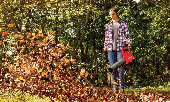 woman in plaid shirt using craftsman cordless blower