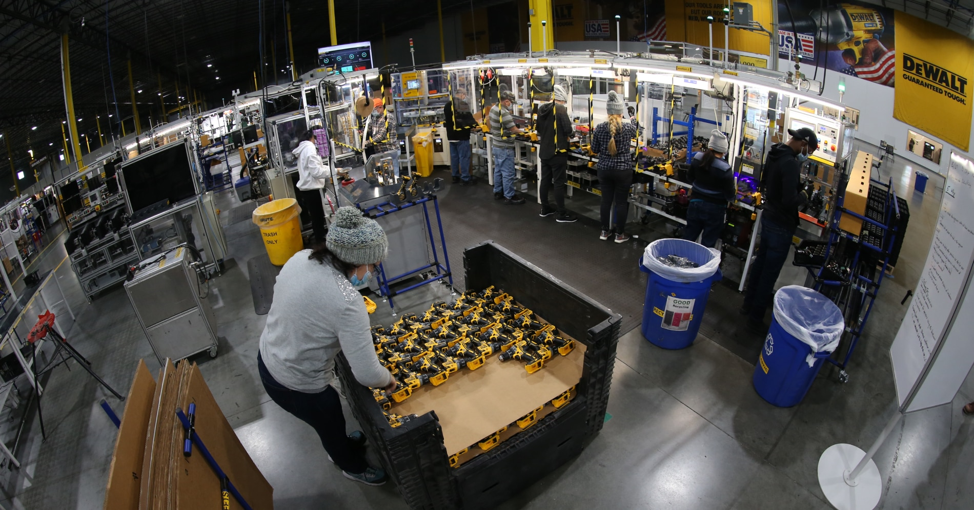 employees assembling dewalt products at the stanley black & decker manufacturing facility in charlotte, nc while wearing ppe
